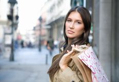 Shopping. Young woman doing holiday shopping at the city center royalty free stock photography