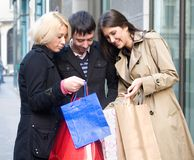 Shopping. Group of friends doing shopping at the city center royalty free stock images