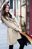 Shopping. Young woman carrying shopping bags stock image