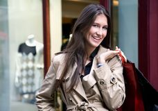 Shopping. Young woman in front of the shopping center royalty free stock photos