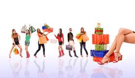 Shopping. Concept by sexy legs with colorful holidays gift boxes and woman blurred in background Stock Photography