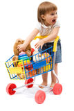 Shopping. Little cute girl playing with toy shopping cart Royalty Free Stock Images