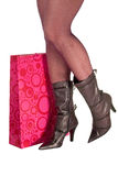 Shopping. Attractive legs with colorful shopping bag Stock Photo