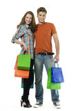 Shopping. Couple smiling. on white background Stock Photo