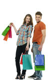Shopping. Couple smiling. on white background Stock Photography
