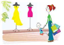 Shopping. Woman is looking on dresses Stock Photo