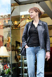 Shopping. Woman leaving the store Stock Photography