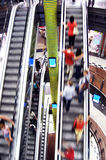 Shopping abstact. Shopping abstract. People rush on escalator motion blurred Stock Image