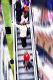 Shopping abstact. Shopping abstract. People rush on escalator motion blurred Royalty Free Stock Image
