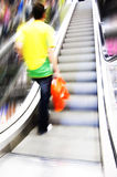 Shopping abstact. Shopping abstract. People rush on escalator motion blurred Royalty Free Stock Images