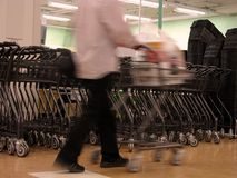 Shopping abstract. Motion blur abstract of a man with shopping cart in a supermarket Royalty Free Stock Images