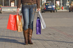 Shopping abstract. Image of a woman legs carrying shopping bags coming from the mega-store.Shot with Canon 70-200mm f/2.8L IS USM Stock Photos