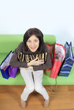 Shopping addict. Woman with lots of bags Stock Photos