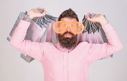 Shopping addicted consumer. How to get ready for your next vacation. Man bearded hipster wear sunglasses while carry lot stock photos