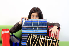 Shopping addiction. Shopping addict woman with lots of bags Royalty Free Stock Photo