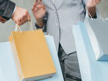 Shopping addict bags hands consumerism store sale stock photos