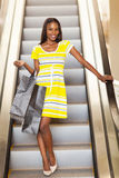 Shopping african woman escalator Stock Images