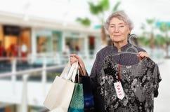 Shopping aged woman Stock Photos