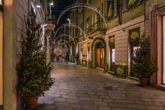 Shopping alley in Milan by night. Via dela Spiga is the exclusive shopping alley in Milan, here you can find all the fashion boutiques royalty free stock photos