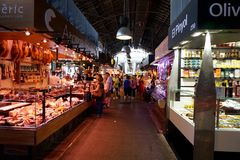 Shopping arcade of the ancient market of Boqueria in Barcelona stock images