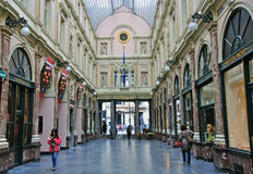 Shopping arcade in Brussels. BRUSSELS, BELGIUM - SEPTEMBER 27: The most famous shopping centre of Brussels downtown on September 27, 2012. Brussels is a capital Royalty Free Stock Image