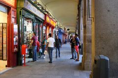 Shopping arcade in the Plaza Mayor in Madrid. MADRID, SPAIN - MAY 24, 2017: This is a shopping arcade along the covered galleries in the Plaza Mayor Royalty Free Stock Photos