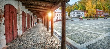 Shopping arcades  in the autumn Plyos. Shopping arcades with wooden shutters on the cobbled square in the autumn Plyos on an early sunny morning Stock Images