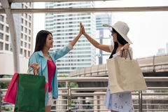 Shopping arrangement of Asian friends. Beautiful Asian women friends see each other by appointment after shopping with many merchant bags. Happy girls enjoy shop Stock Images
