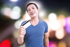 Shopping. Asian Man With Credit Card With Colorfuls Night Life Royalty Free Stock Photo