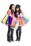 Shopping asian women. An isolated shot of two beautiful asian women carrying shopping bags Stock Photography