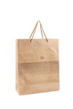 Shopping bag. Brown shopping bag and puzzles with white background Royalty Free Stock Photo