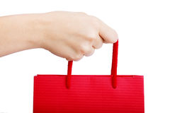 Shopping bag. Hand holding red shopping bag. Concepts: Shopping & consumerism Royalty Free Stock Images