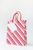 Shopping bag. Red stripe shopping bag  on white background Stock Photo