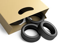Shopping bag with automative tyres. On white background 3d image Royalty Free Stock Images