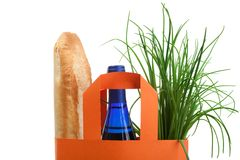 Shopping bag with bread, bottle and greenery Stock Photo
