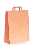 Shopping bag of brown paper on white background Royalty Free Stock Photography