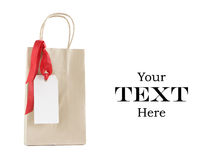 Shopping bag with christmas tag Royalty Free Stock Photo
