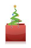 Shopping bag with christmas tree inside Stock Image