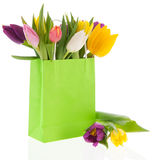 Shopping bag colorful tulips Royalty Free Stock Photos