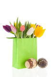 Shopping bag colorful tulips with easter eggs Royalty Free Stock Photography
