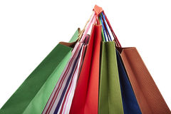 Shopping bag consumerism retail. Collection of shopping bags hanging on white background with clipping path Stock Photos