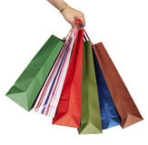 Shopping bag consumerism retail. Hand holding collection of shopping bags on white background with clipping path Stock Photography