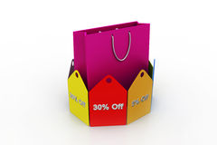 Shopping bag with discount tags Royalty Free Stock Photography
