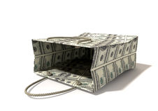 Shopping Bag Dollar Notes Laying Down. A perspective view of a  paper shopping bag with rope handles tipped on its side clad in $200 dollar bills on an isolated Royalty Free Stock Image