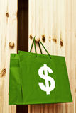 Shopping bag with dollar symbol Royalty Free Stock Image