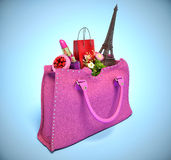 Shopping bag and the Eiffel Tower in handbags. Royalty Free Stock Images
