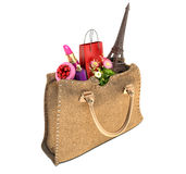 Shopping bag and the Eiffel Tower in handbags. Stock Photos
