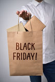 Shopping bag full of boxes and text black friday Stock Photos