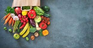 Shopping bag full of fresh vegetables and fruits stock image