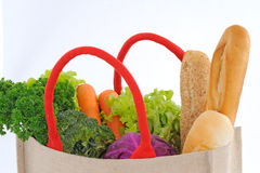 Shopping bag full of groceries. Isolated on white background Stock Photography